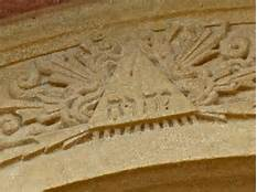 """God"" in Hebrew letters above the front doors of the Cathedral in Santa Fe."