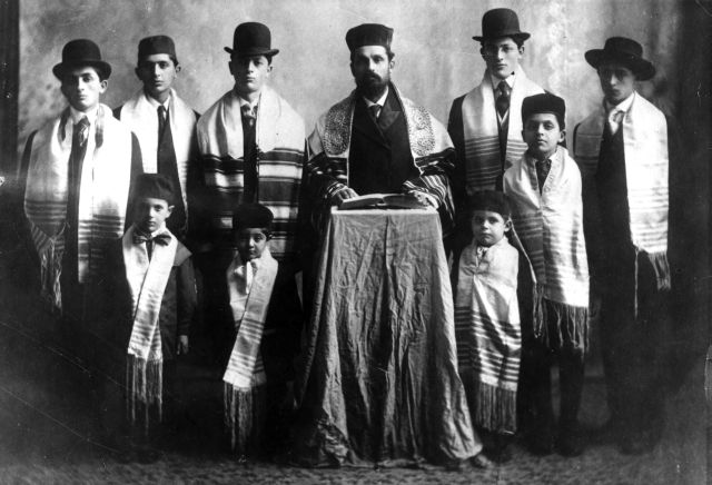 """Reverend Papaermaster, his 8 sons and first grandson, Grand Forks, ND, 1908. #WS0231"