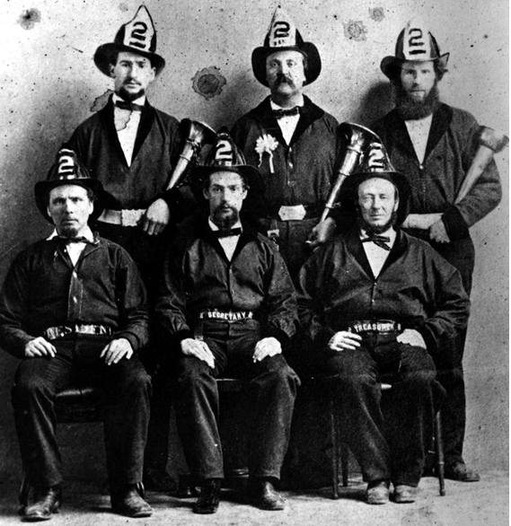 Tiger Engine Co #2, H. Levy standing left, Frank Sylvester in middle.