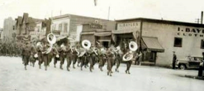 1940's Parade Passes Ike Bayles's Store in Anchorage.